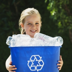 bigstock_Little_Girl_Holding_Recycling__3911999